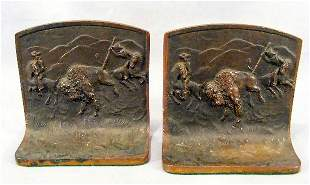 Pair of bronze bookends, Buffalo Hunt, each marked