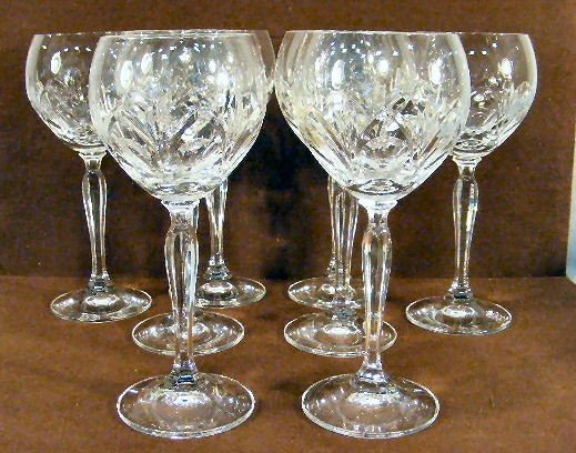 8E: Set of 8 crystal wine glasses marked with a crown o