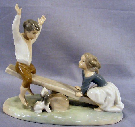 "18A: Lladro figurine of boy & girl on seesaw, 9"" long &"