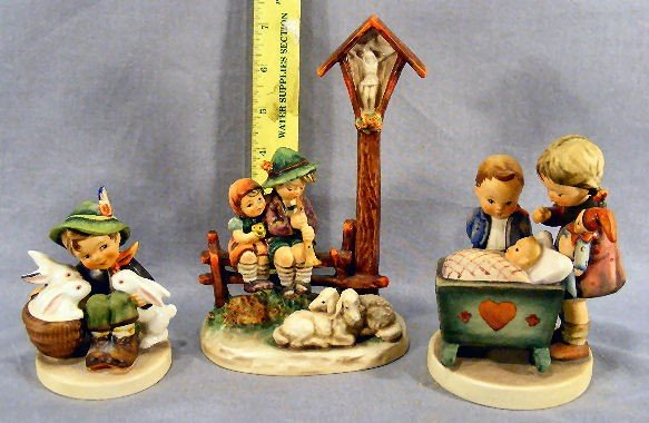 6G: Three Hummel figurines, 28/II, 333, with some crazi