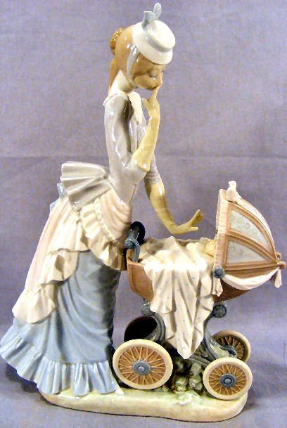 9G: Large Lladro figurine, lady with baby carriage, exc