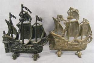 Two ship cast iron doorstops, one with black paint