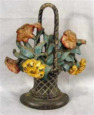 Cast iron doorstop, flower basket, impressed 120 o