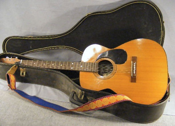 54A: Conqueror acoustic guitar, w/case. Finish/ wood is