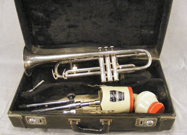 57A: Estate silver colored trumpet with case, stand & 2