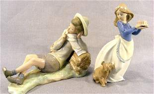 """Lladro figurine of boy, 9"""" long, damage on foot and"""