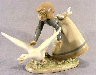 "Lladro figurine #5553, 6"" high, girl chasing goose"