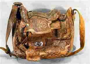 Estate tooled leather western saddle shoulder bag,