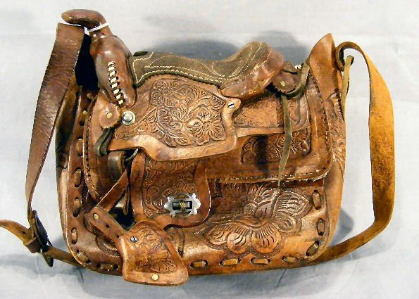 12F: Estate tooled leather western saddle shoulder bag,