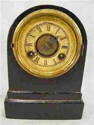 "Terry Clock eight day clock, metal case, 6"" high,"