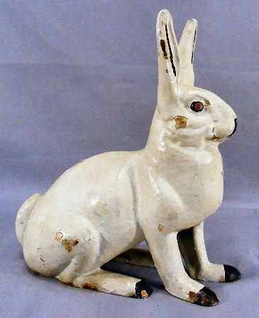 51M: Cast iron rabbit lawn ornament / door stop, painte