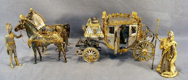 100T: Sterling silver coach & figurines made in 1973 an