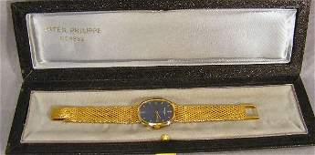 121P: Patek Philippe 18K gold Ellipse wristwatch with 1