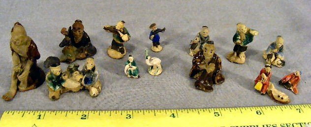 16E: Lot of 12 miniature Chinese mud figures, tallest m