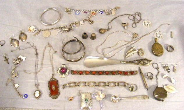 21A: Sterling and silver jewelry, etc. Bangles, charm b