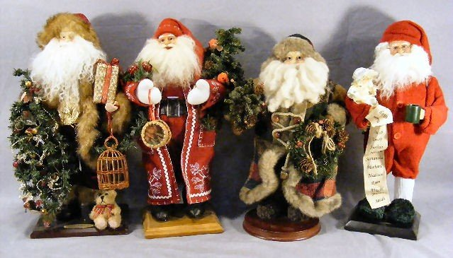 "15G: Four Santa Claus figurines, 16"" - 18"" tall"
