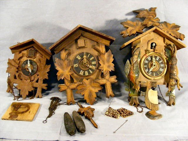 22L: Three cuckoo clocks, sold as is - pieces missing