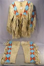 153P: Northern Plains Indian man's  beaded hide shirt a