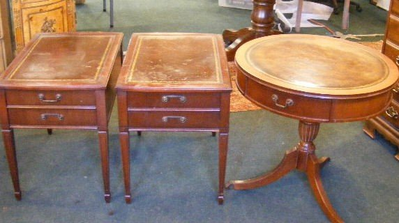 137T: Two leather top one drawer end tables and drum ta