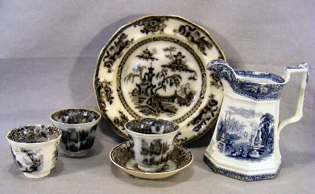 20P: Three mulberry handle less cups and one saucer, 10
