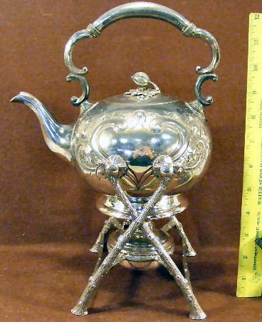 23H: Silver plated tea pot on stand with burner, floral