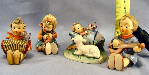 21H: Lot of four Hummel figurines, no damage or crazing