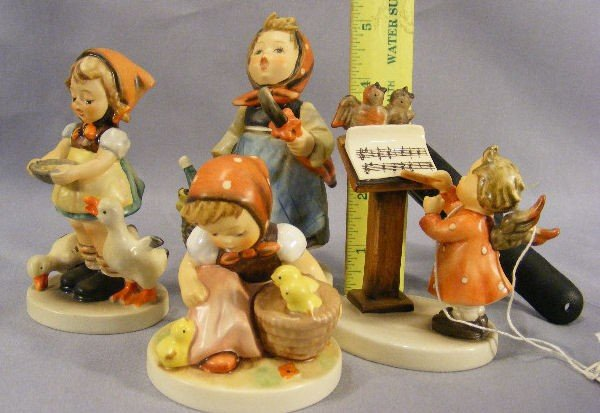 22H: Lot of four Hummel figurines, no damage or crazing