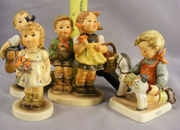 23H: Lot of four Hummel figurines, no damage or crazing