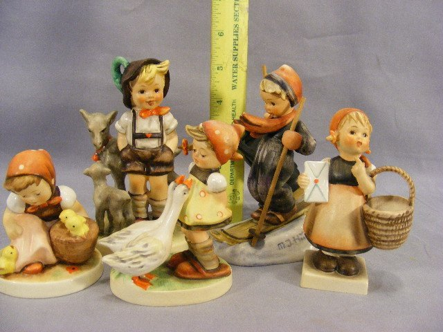 15M: Lot of five Hummel figurines, two largest with cra