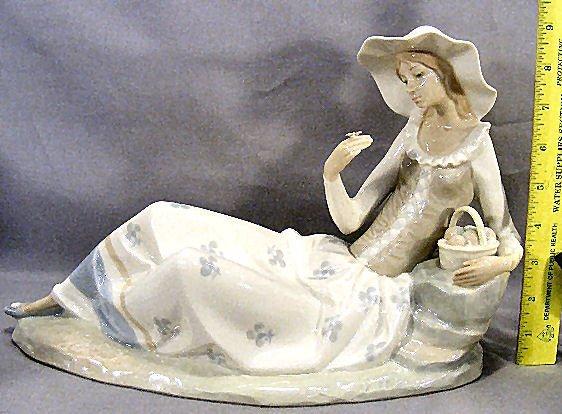 "19S: Large NAO figurine of girl holding flower, 13"" lon"