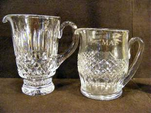 Two Waterford crystal pitchers, shorter with etched