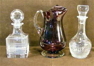 Two clear decanters, one with bruise on edge of st