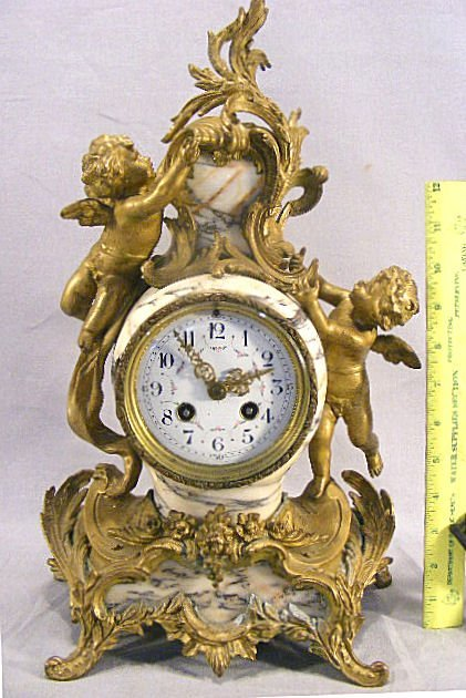 29G: Antique French marble mantel clock with cupids, 17