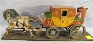 Folk art carved wood horses pulling carriage, typi
