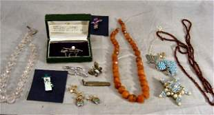 Lot of costume jewelry pins, necklaces, beads, etc