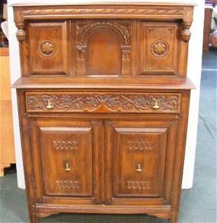 "Carved oak cabinet, 55.5"" high, 40"" wide, Eudal Oa"
