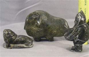 Three Eskimo stone carvings, bear, seal and man, b