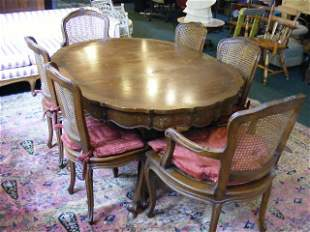 French provincial styled dining room table with si