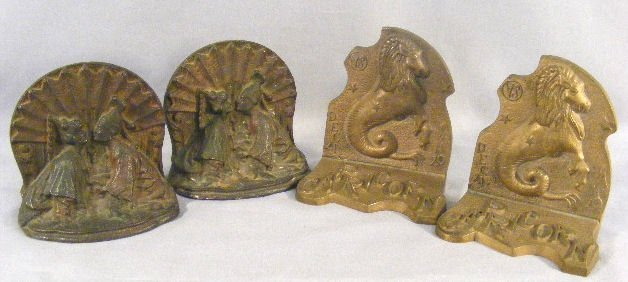 7L: Pair of bronze Capricorn bookends and pair of iron
