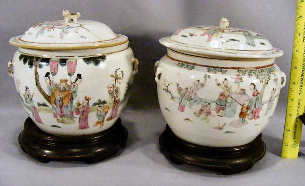 "22L: Pair of Chinese covered jars, 7"" high, chip on one"