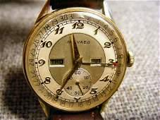 185B: Movado 14K gold calendar watch, 17 jewels, engrav