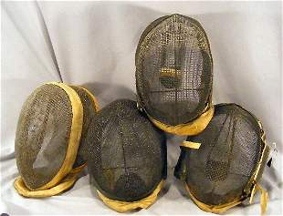 4 vintage fencing masks. See photos for details.