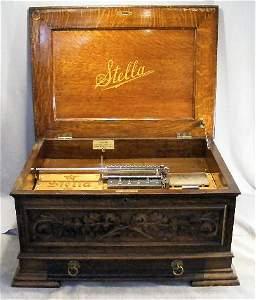 85Z: 1897 Stella Grand Music Box, #168, oak case. Case