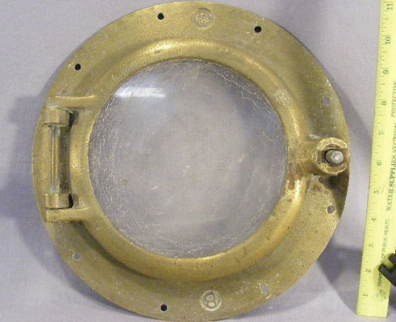 """99N: Brass & glass porthole, marked CW an """"8"""", missing"""