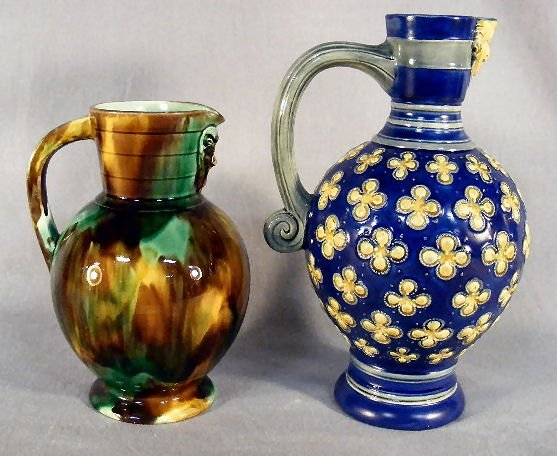 "1A: Two majolica jugs with Bellermine spouts, 9.75"" cob"