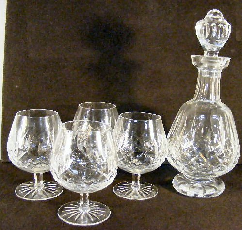 10L: Waterford Lismore crystal footed decanter and four