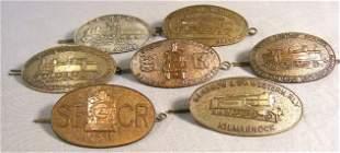 Lot of seven English railroad cap badges, all backs