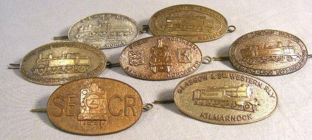1F: Lot of seven English railroad cap badges, all backs