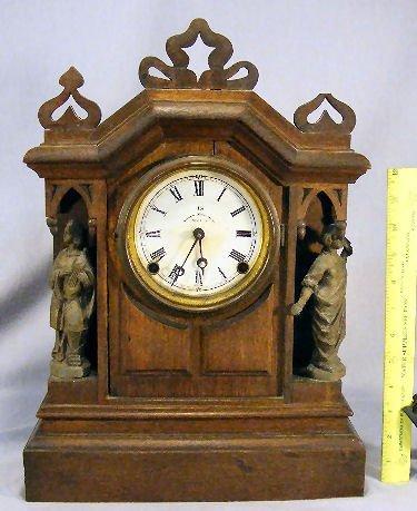 19B: U.S. Clock Company walnut case clock with spelter
