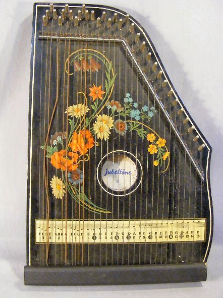 1A: Two German zithers, Jubeltone salon harp, and Ameri